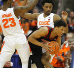 Louisville's Dwayne Sutton, center, tries to get around Syracuse's Frank Howard, left, and Elijah Hughes, right, during the second half of an NCAA college basketball game in Syracuse, N.Y., Wednesday, Feb. 20, 2019. Syracuse won 69-49. (AP Photo/Nick Lisi)