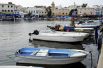 A view of the port of Bizerte, Tunisia, where boats similar to the ones used by migrants to reach Italy are docked, Wednesday, Sept. 23, 2020. The number of Tunisians migrating clandestinely to Italy has risen to levels not seen since the 2011 Arab Spring uprising. That's causing tensions in Italy's south, where more than 2,200 migrants are quarantining on ferries anchored offshore. (AP Photo/Hassene Dridi)