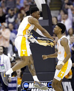 Tennessee's Admiral Schofield, left, and Kyle Alexander celebrate after they defeated Iowa in overtime during a second-round men's college basketball game in the NCAA Tournament in Columbus, Ohio, Sunday, March 24, 2019.(AP Photo/Tony Dejak)