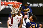 Washington State center Efe Abogidi (0) dunks next to California guard Jarred Hyder (3) during the first half of an NCAA college basketball game Thursday, Feb. 18, 2021, in Pullman, Wash. (AP Photo/Pete Caster)