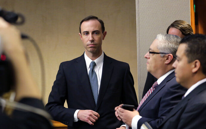 FILE - In this Feb. 7, 2019 file photo, Secretary of State David Whitley, left, arrives for his confirmation hearing in Austin, Texas, where he addressed the backlash surrounding Texas' efforts to find noncitizen voters on voter rolls. A key Texas Democrat says he won't back Whitley, Gov. Greg Abbott's embattled choice for secretary of state, whose job is in peril over an inaccurate list of 95,000 voters flagged as possible non-U.S. citizens. (AP Photo/Eric Gay, File)
