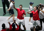 Canada's Denis Shapovalov, right, and his partner Vasek Pospisil celebrate after winning their Davis Cup semifinal doubles match against Russia's Karen Khachanov and Andrey Rublev, in Madrid, Spain, Saturday, Nov. 23, 2019. (AP Photo/Bernat Armangue)