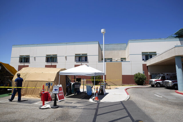 A tent sits in front of the El Centro Regional Medical Center to help process patients with symptoms related to the new coronavirus Wednesday, May 20, 2020, in El Centro, Calif. As much of California inches toward businesses reopening, this farming region on the state's border with Mexico is grappling with a spike in hospitalizations from the coronavirus that could inflict more pain on its perpetually struggling economy. (AP Photo/Gregory Bull)