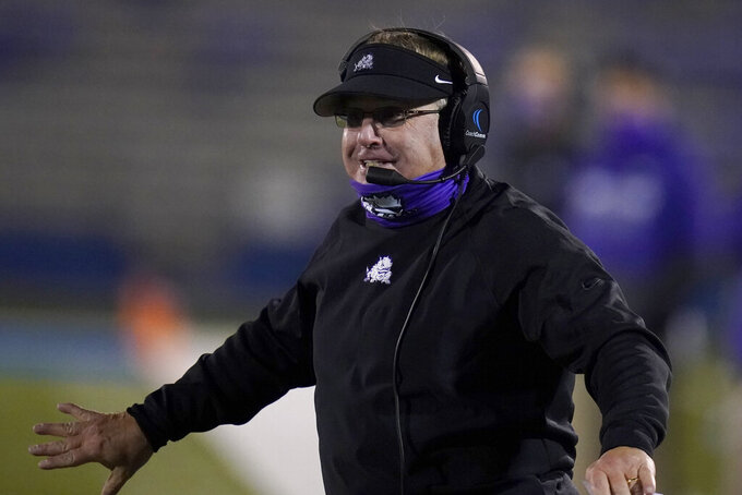 TCU coach Gary Patterson directs his team during the second half of an NCAA college football game against Kansas in Lawrence, Kan., Saturday, Nov. 28, 2020. TCU won 59-23. (AP Photo/Orlin Wagner)