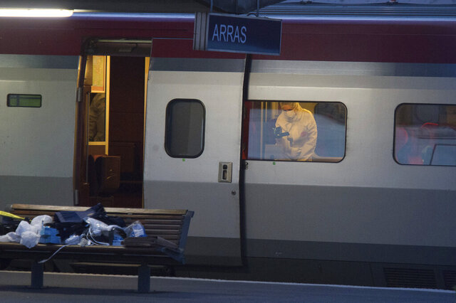 FILE - In this Aug.21, 2015 file photo, a police officer videos the crime scene inside a Thalys train at Arras train station, northern France, after a gunman opened fire with an automatic weapon. No one died, but few if any passengers on car 12 of a train to Paris would have reached their destination alive if the attack plot five years ago had gone off as planned, prosecutors contended at the month-long trial of an Islamic State operative. The proceedings end Thursday with the verdict. (AP Photo, File)