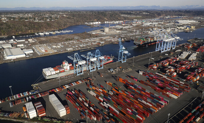 FILE - In this March 5, 2019, file photo, cargo containers are staged near cranes at the Port of Tacoma, in Tacoma, Wash. China has announced tariff hikes on $60 billion of U.S. goods in retaliation for President Donald Trump's escalation of a fight over technology and other trade disputes. The Finance Ministry said Monday, May 13, the penalty duties of 5% to 25% on hundreds of U.S. products including batteries, spinach and coffee take effect June 1. (AP Photo/Ted S. Warren, File)