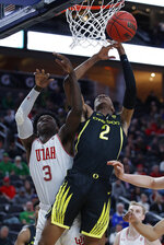 Oregon's Louis King (2) shoots around Utah's Donnie Tillman during the second half of an NCAA college basketball game in the quarterfinals of the Pac-12 men's tournament Thursday, March 14, 2019, in Las Vegas. (AP Photo/John Locher)