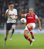 Tottenham Hotspur's Ashleigh Neville, left, and Arsenal's Katie Mccabe battle for the ball during their Women's Super League soccer match at the Tottenham Hotspur Stadium in London, Sunday Nov. 17, 2019.  The match drew a record crowd of 38,262 for the competition on Sunday when Arsenal claimed a 2-0 victory at Tottenham. (Zac Goodwin/PA via AP)