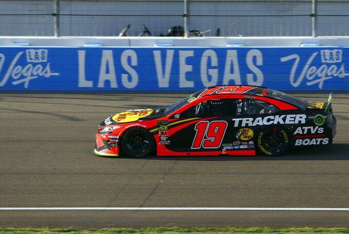Martin Truex Jr. (19) drives during a NASCAR Cup Series auto race at Las Vegas Motor Speedway, Sunday, Sept. 15, 2019. (AP Photo/Chase Stevens)
