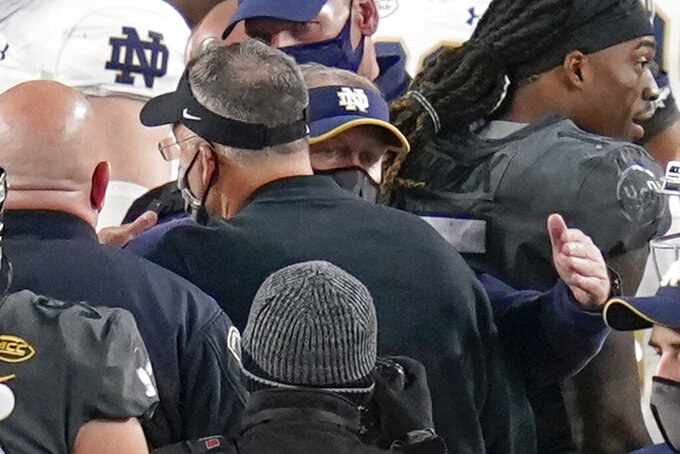 Notre Dame head coach Brian Kelly, center right, meets Pittsburgh head coach Pat Narduzzi in the middle of the field after their NCAA college football game Saturday, Oct. 24, 2020, in Pittsburgh.  (AP Photo/Keith Srakocic)