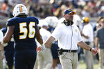 Chattanooga NCAA college football assistant coach Chris Malone congratulates Malcom White (56) after a touchdown during a college football game against Western Carolina in Chattanooga, Tenn., in this Sept. 28, 2019, file photo. The Chattanooga football assistant coach fired over a social media post disparaging the state of Georgia and voting rights advocate Stacey Abrams is suing to get his job back along with back pay and damages. He contends his First Amendment rights were violated. Malone says he was forced to resign Jan. 7 in the lawsuit filed Tuesday, April 27, 2021, in the Eastern District of U.S. District Court. (Robin Rudd/Chattanooga Times Free Press via AP)