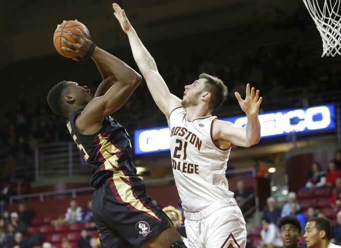 Florida State's Mfiondu Kabengele, left, tries to drive past Boston College's Nik Popovic, right, in the first half of an NCAA college basketball game, Sunday, Jan. 20, 2019, in Boston. (AP Photo/Steven Senne)