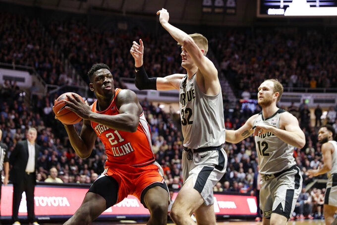 Illinois center Kofi Cockburn (21) looks to shoot over Purdue center Matt Haarms (32) during the first half of an NCAA college basketball game in West Lafayette, Ind., Tuesday, Jan. 21, 2020. (AP Photo/Michael Conroy)