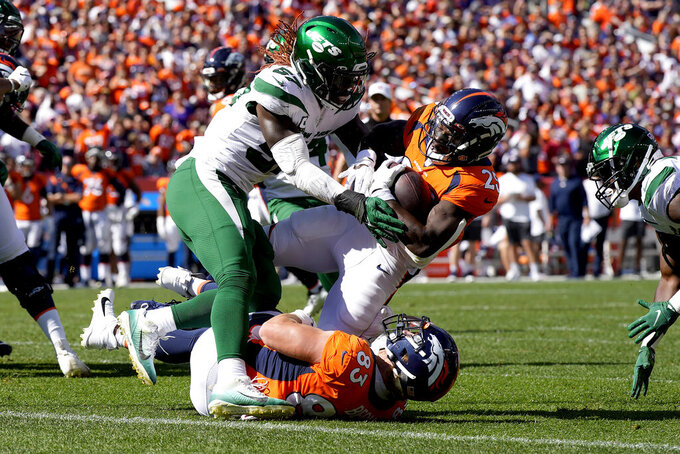 Denver Broncos running back Melvin Gordon (25) is stopped at the goal line by New York Jets middle linebacker C.J. Mosley during the first half of an NFL football game, Sunday, Sept. 26, 2021, in Denver. (AP Photo/David Zalubowski)