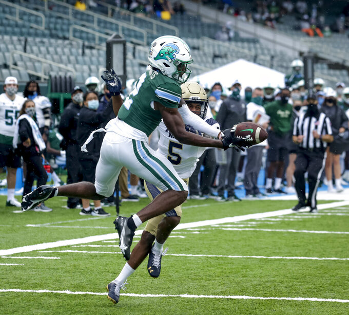 Tulane wide receiver Duece Watts (2) can't make the catch against Navy cornerback Michael McMorris (5) during the first half of an during an NCAA college football game, Saturday, Sept. 19, 2020, in New Orleans. (Scott Threlkeld/The Times-Picayune/The New Orleans Advocate)