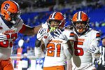 Syracuse's Moe Neal (21) celebrates with Chris Elmore (5) and Evan Adams (63) after scoring a touchdown during the second half of an NCAA college football game against Duke in Durham, N.C., Saturday, Nov. 16, 2019. (AP Photo/Ben McKeown)