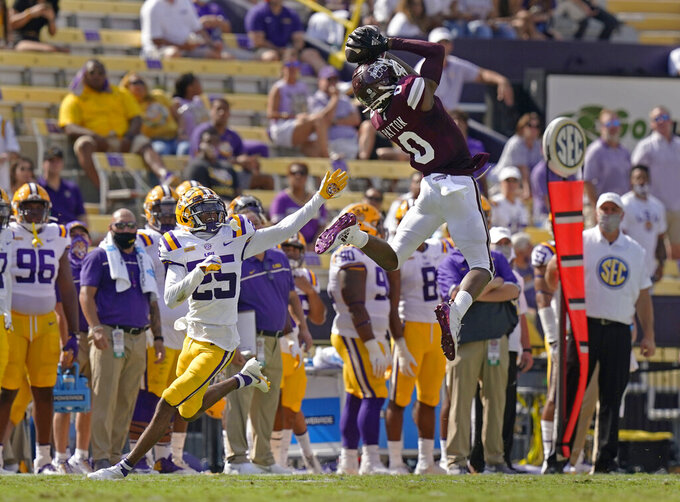 Mississippi State wide receiver JaVonta Payton (0) pulls in a pass over LSU cornerback Cordale Flott (25) in the first half an NCAA college football game in Baton Rouge, La., Saturday, Sept. 26, 2020. (AP Photo/Gerald Herbert)