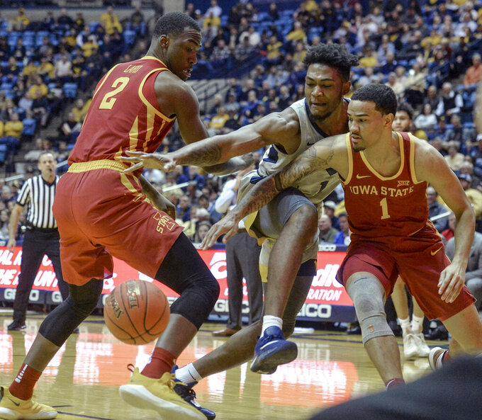West Virginia forward Derek Culver (1),  Iowa State forward Cameron Lard (2) and Iowa State guard Nick Weiler-Babb (1) go for the loose ball during the first half of an NCAA college basketball game Wednesday, March 6, 2019, in Morgantown, W.Va. (William Wotring/The Dominion-Post via AP)