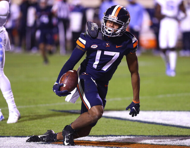 Virginia wide receiver Ra'Shaun Henry (17) scores a touchdown against North Carolina during an NCAA college football game Saturday, Oct. 31, 2020, in Charlottesville, Va. (Andrew Shurtleff/The Daily Progress via AP)