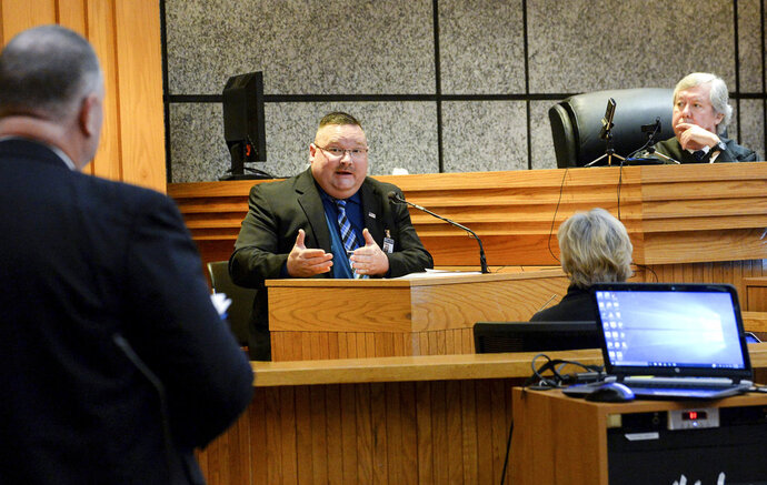David Wagner, left, Tenth Circuit Solicitor, and Judge Edgar Long, right, listens to Tracy Call, middle, Anderson County Sheriff's office investigator, during a waiver hearing for Jesse Osborne at the Anderson County Courthouse in Anderson, S.C., on Monday, Feb. 12, 2018. (Ken Ruinard/The Independent-Mail via AP, Pool)