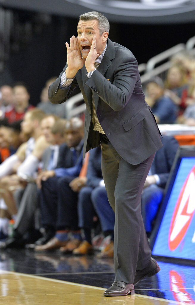 Virginia head coach Tony Bennett shouts instructions to his team during the first half of an NCAA college basketball game against Louisville in Louisville, Ky., Saturday, Feb. 23, 2019. (AP Photo/Timothy D. Easley)