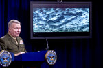 Video of the Abu Bakr al-Baghdadi raid is displayed as U.S. Central Command Commander Marine Gen. Kenneth McKenzie speaks, Wednesday, Oct. 30, 2019, at a joint press briefing at the Pentagon in Washington. (AP Photo/Andrew Harnik)