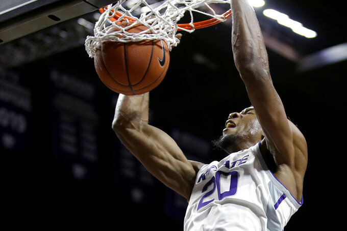 Kansas State's Xavier Sneed (20) dunks the ball during the second half of an NCAA college basketball game against Alabama State Wednesday, Dec. 11, 2019, in Manhattan, Kan. (AP Photo/Charlie Riedel)
