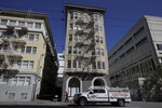 A hazardous material emergency truck is shown parked in front of the Abigail Hotel in San Francisco, Thursday, April 2, 2020. The hotel is one of several private hotels San Francisco has contracted with to take vulnerable people who show symptoms or are awaiting test results for the coronavirus. (AP Photo/Jeff Chiu)