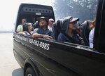 Tourists ride through a smoky and hazy vista from Tunnel View as Yosemite National Park reopens in California, Tuesday, Aug. 14, 2018. The nearly three-week closure was the result of a wildfire. (AP Photo/Gary Kazanjian)