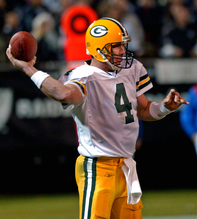 FILE In this Dec. 22, 2003, file photo, Green Bay Packers quarterback Brett Favre throws a pass against the Oakland Raiders in the second quarter of an NFL football game in Oakland, Calif. When it comes to emotional games, his four-touchdown against the Raiders the day after his father's death in 2003 stands out above all the rest.  (AP Photo/Paul Sakuma, File)
