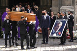 """Pallbearers carry the coffin of actor Jean-Paul Belmondo after his funeral service at the Saint Germain des Pres church, Friday, Sept. 10, 2021 in Paris. The star of the iconic French New Wave film """"Breathless"""" died Monday aged 88. (AP Photo/Michel Euler)"""