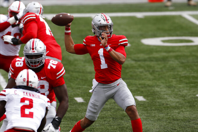 Ohio State quarterback Justin Fields throws a pass against Nebraska during the first half of an NCAA college football game Saturday, Oct. 24, 2020, in Columbus, Ohio. (AP Photo/Jay LaPrete)
