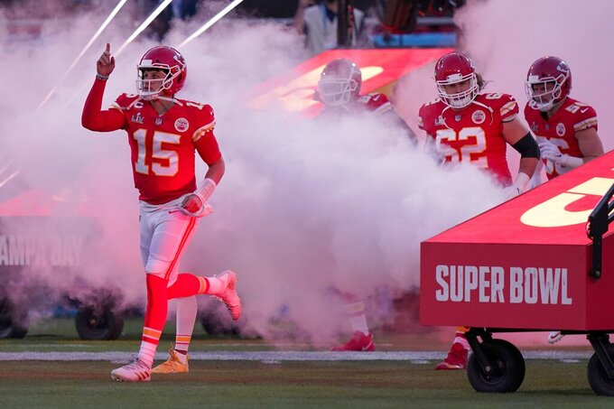 Kansas City Chiefs quarterback Patrick Mahomes runs onto the field before the NFL Super Bowl 55 football game against the Tampa Bay Buccaneers, Sunday, Feb. 7, 2021, in Tampa, Fla. (AP Photo/Lynne Sladky)