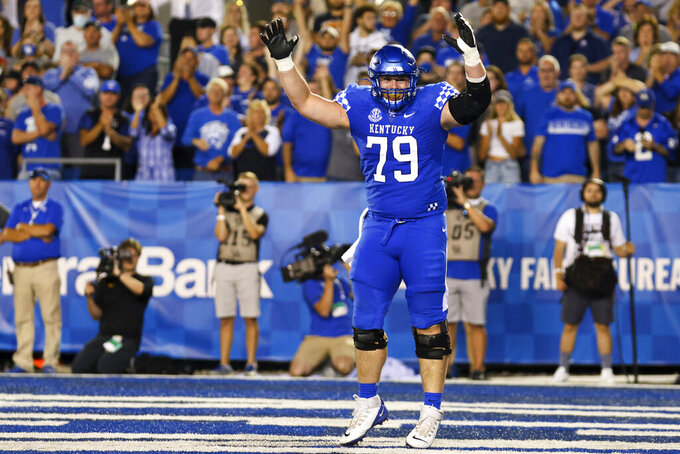 Kentucky guard Luke Fortner (79) celebrates a touchdown to put Kentucky up 35-28 during the fourth quarter of an NCAA college football game against Missouri in Lexington, Ky., Saturday, Sept. 11, 2021. (AP Photo/Michael Clubb)