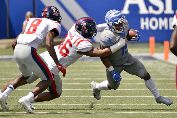 Memphis running back Kenneth Gainwell (19) carries the ball against Mississippi linebacker MoMo Sanogo (46) and defensive back C.J. Miller (8) in the second half of an NCAA college football game Saturday, Aug. 31, 2019, in Memphis, Tenn. (AP Photo/Brandon Dill)