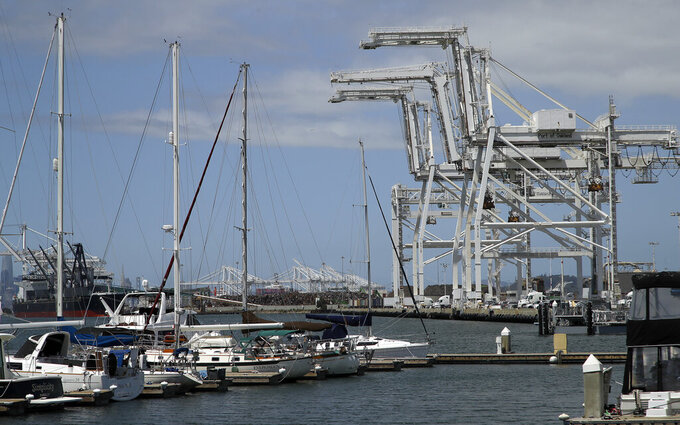 FILE - In this Friday, May 17, 2019, file photo, shipping cranes and a marina are near the Howard terminal area of the Port of Oakland in Oakland, Calif. The Oakland City Council approved preliminary terms for a new $12 billion waterfront ballpark project for the Athletics, Tuesday, July 20, 2021. But it's not clear if the 6-1 vote will be enough to keep the A's at the negotiating table instead of leaving the city. (AP Photo/Ben Margot, File)