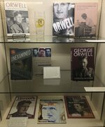 In this Oct. 21, 2019, photo, books and magazines about the novelist George Orwell are shown at an exhibit in Albuquerque, N.M. celebrating the author's legacy. The exhibit at the University of New Mexico is tackling the themes of the novelist's work from