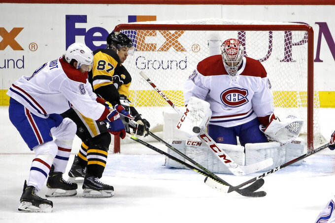 FILE - In this Feb. 14, 2020, file photo, Pittsburgh Penguins' Sidney Crosby (87) can't deflect a shot in front of Montreal Canadiens goaltender Carey Price (31) with Ben Chiarot (8) defending during the third period of an NHL hockey game in Pittsburgh. Crosby doesn't mind going directly into playoffs given the limited timing. His reward is a matchup against elite goaltender Price and the Canadiens. (AP Photo/Gene J. Puskar, File)