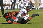 Oklahoma State defensive tackle Israel Antwine (95) tackles TCU running back Darius Anderson (6) in the first half of an NCAA college football game in Stillwater, Okla., Saturday, Nov. 2, 2019. (AP Photo/Sue Ogrocki)