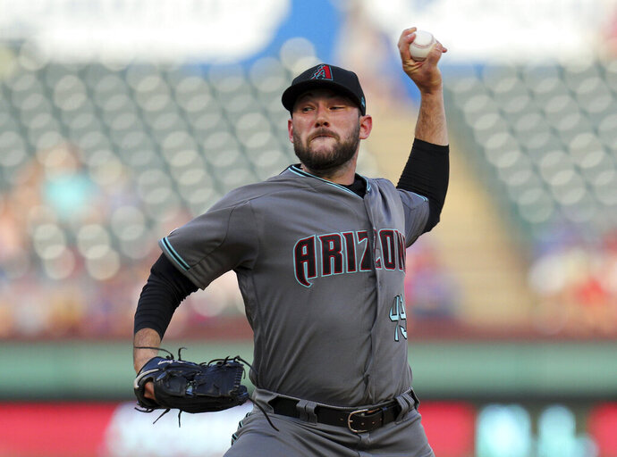 Arizona Diamondbacks starting pitcher Alex Young (49) delivers against the Texas Rangers in the first inning of a baseball game Tuesday, July 16, 2019 in Arlington, Texas. (AP Photo/ Richard W. Rodriguez)