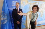 Iraq's Culture Minister Abdulamir al-Dafar Hamdani, left, is welcomed by UNESCO'S Director-General Audrey Azoulay at the UNESCO's headquarters in Paris, Wednesday, Sept. 11. 2019. Iraqi officials meet at the UN's cultural agency in Paris to discuss plans for an ambitious $100 million reconstruction of the Islamic State-ravaged city of Mosul. (AP Photo/Michel Euler) HAMDANI