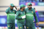 Pakistan's captain Sarfaraz Ahmed, center, and teammates leave the field after their win over England in the Cricket World Cup match at Trent Bridge in Nottingham, Monday, June 3, 2019. (AP Photo/Rui Vieira)