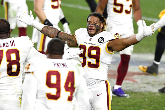 Washington Football Team defensive end Chase Young (99) celebrates after a win over the Pittsburgh Steelers in an NFL football game in Pittsburgh, Monday, Dec. 7, 2020. (AP Photo/Barry Reeger)