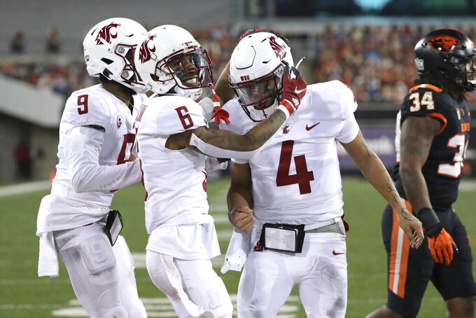 Washington State wide receivers Jamire Calvin (6) and Renard Bell (9) celebrate after their quarterback Jayden de Laura (4) scored a touchdown during the second half of an NCAA college football game against Oregon State in Corvallis, Ore., Saturday, Nov. 7, 2020. Washington State won 38-28. (AP Photo/Amanda Loman)