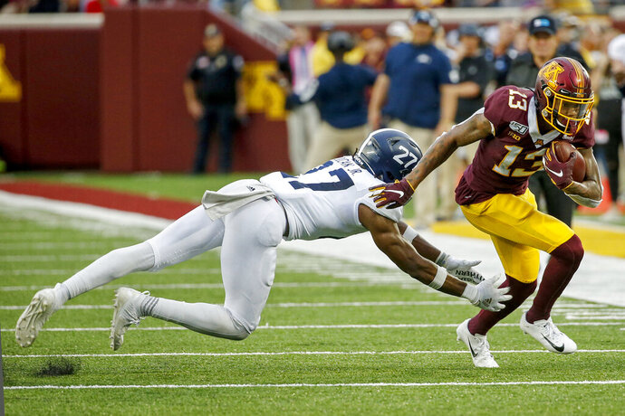 Minnesota wide receiver Rashod Bateman (13) catches a pass and leaves Georgia Southern safety Kenderick Duncan Jr. (27) behind in the fourth quarter of an NCAA college football game Saturday, Sept. 14, 2019, in Minneapolis. (AP Photo/Bruce Kluckhohn)