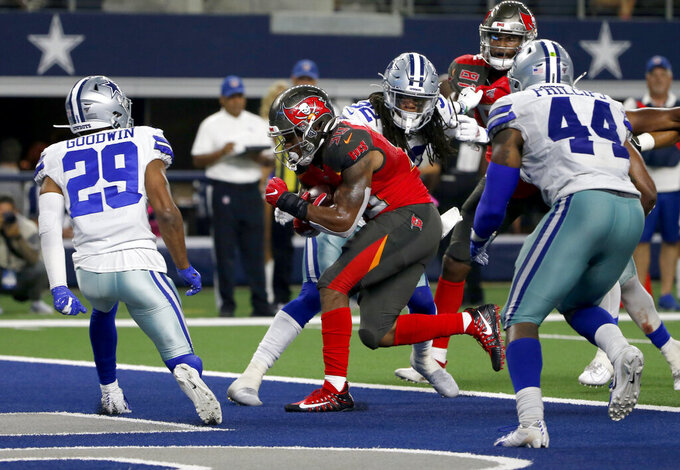 Dallas Cowboys' C.J. Goodwin (29) and linebacker Justin Phillips (44) are unable to stop Tampa Bay Buccaneers running back Bruce Anderson III (30) from running the ball for a touchdown in the second half of a preseason NFL football game in Arlington, Texas, Thursday, Aug. 29, 2019. (AP Photo/Michael Ainsworth)