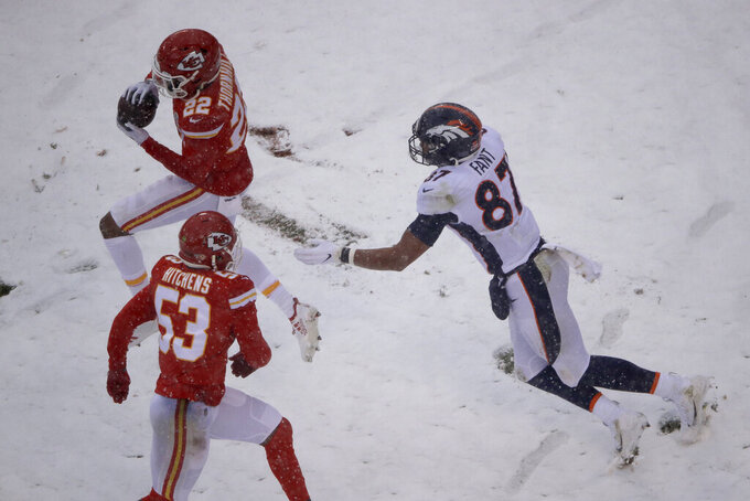 Kansas City Chiefs safety Juan Thornhill (22) intercepts a pass intended for Denver Broncos tight end Noah Fant (87), as linebacker Anthony Hitchens (53) looks on, during the second half of an NFL football game in Kansas City, Mo., Sunday, Dec. 15, 2019. (AP Photo/Charlie Riedel)