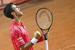 Serbia's Novak Đjoković celebrates winning his match with Argentina's Diego Sebastián Schwartzman during their final match at the Italian Open tennis tournament, in Rome, Monday, Sept. 21, 2020. (Alfredo Falcone/LaPresse via AP)