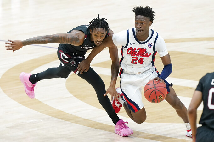 Mississippi's Jarkel Joiner (24) moves past South Carolina's T.J. Moss in the first half of an NCAA college basketball game in the Southeastern Conference Tournament Thursday, March 11, 2021, in Nashville, Tenn. (AP Photo/Mark Humphrey)
