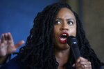 FILE - In this July 21, 2019 file photo, U.S. Rep. Ayanna Pressley, D-Mass., addresses a crowd during ceremonies before the start of the Roxbury Unity Parade in Boston's Roxbury neighborhood. Pressley, who has yet to back any of the Democrats seeking the party's nomination for president in 2020, told the Associated Press, Monday, Nov. 4, that several top party candidates are seeking her endorsement. (AP Photo/Steven Senne, File)